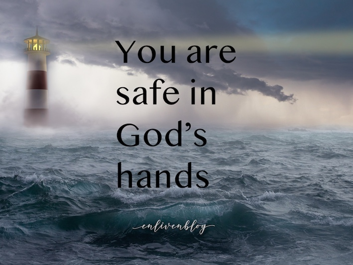 """Iighthouse in storm, text """"you are safe in God's hands"""""""